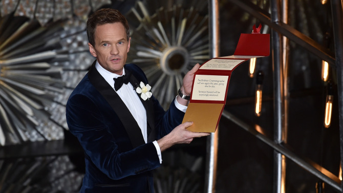 Host Neil Patrick Harris opens his locked envelope onstage during the 87th Annual Academy Awards at Dolby Theatre on February 22, 2015 in Hollywood, California.