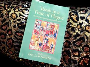 Torah in a Time of Plague, deposited on a pillow with animal print sequins.