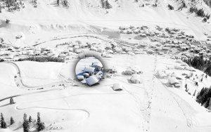 Lage Bergland Appartement im Winter - Ansicht vom Paragleitschirm - mitten im Skigebiet, direkt an der Piste