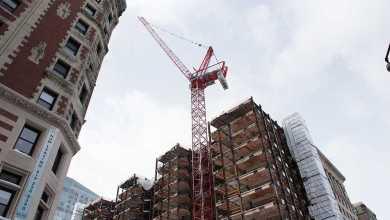 The crane will remain on the Little Building till November or December. Photo: Daniel Peden / Beacon Staff
