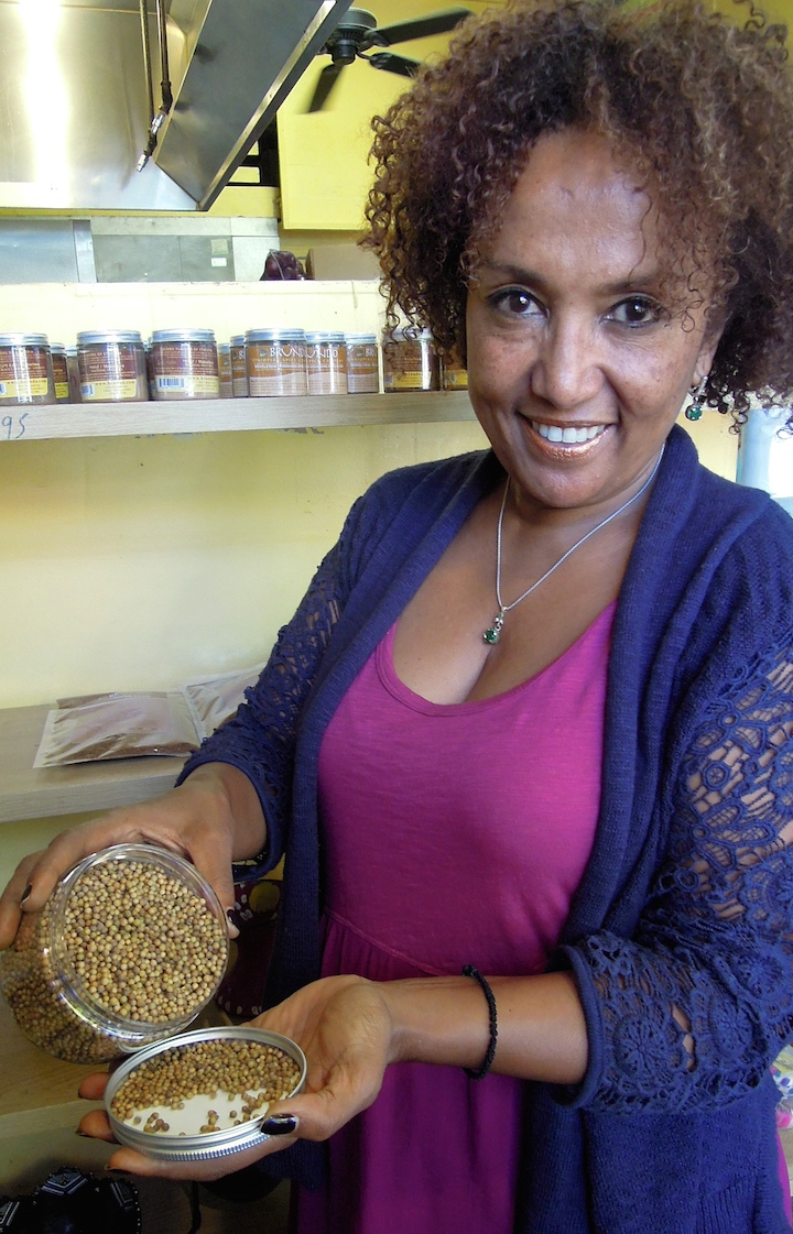 Fetlework Tefferi holds Ethiopian-grown coriander. photo: Anna Mindess
