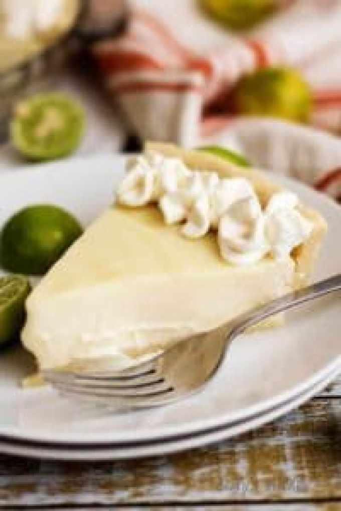 A homemade silky smooth key lime pie that's creamy, sweet, and tangy and is prepared with authentic key lime juice. It's the perfect pie for Spring!