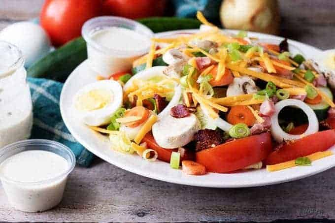 Our copycat classic diner chef salad is a throwback to that perfect entree you just can't seem to find anymore. It's loaded with cheese, ham, and bacon!