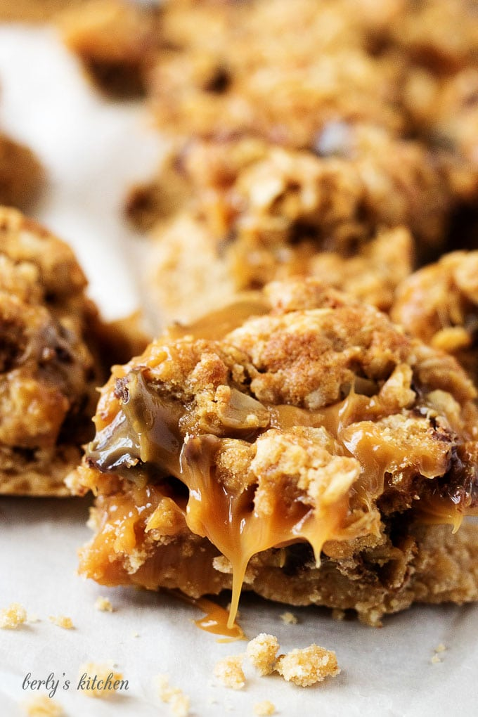 Ooey, gooey, and dripping with caramel, Chocolate Oat Carmelita Bars are the way to satisfy any sweet tooth.  Who can resist a layer of melted caramel and chocolate sandwiched between a shortbread crust and oatmeal topping?