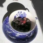 black raspberries in a vintage cup