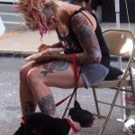 tattooed woman with dog