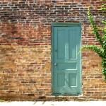 green door in brick wall