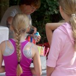 two girls in pink wait for their snowcone