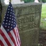 civil-war era headstone with flag