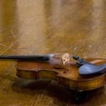 violin on an oak table