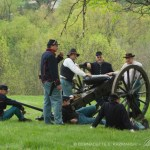 civil war re-enactors waiting around cannon