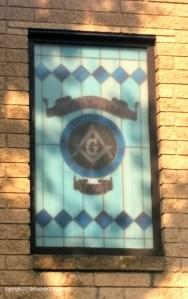 Window in the Mason's lodge building.