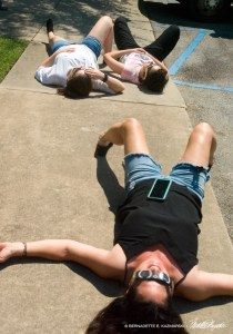 Jennifer Cassidy and Christianson work on their tan while watching the sky.
