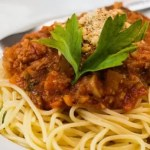 Tasty spaghetti bolognese with a vegetarian minced meat of seitan and tomato sauce