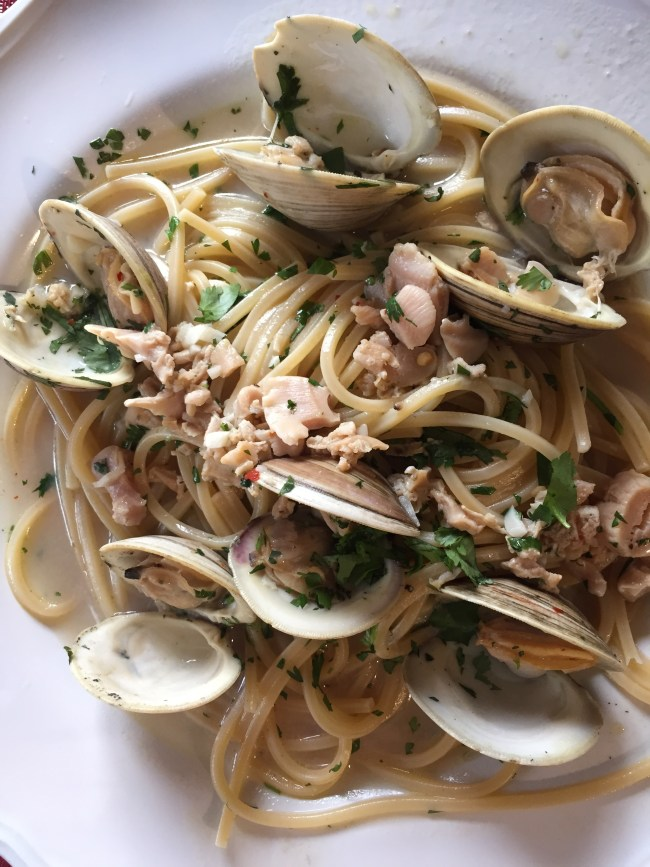 clams and luingine in white wine sauce