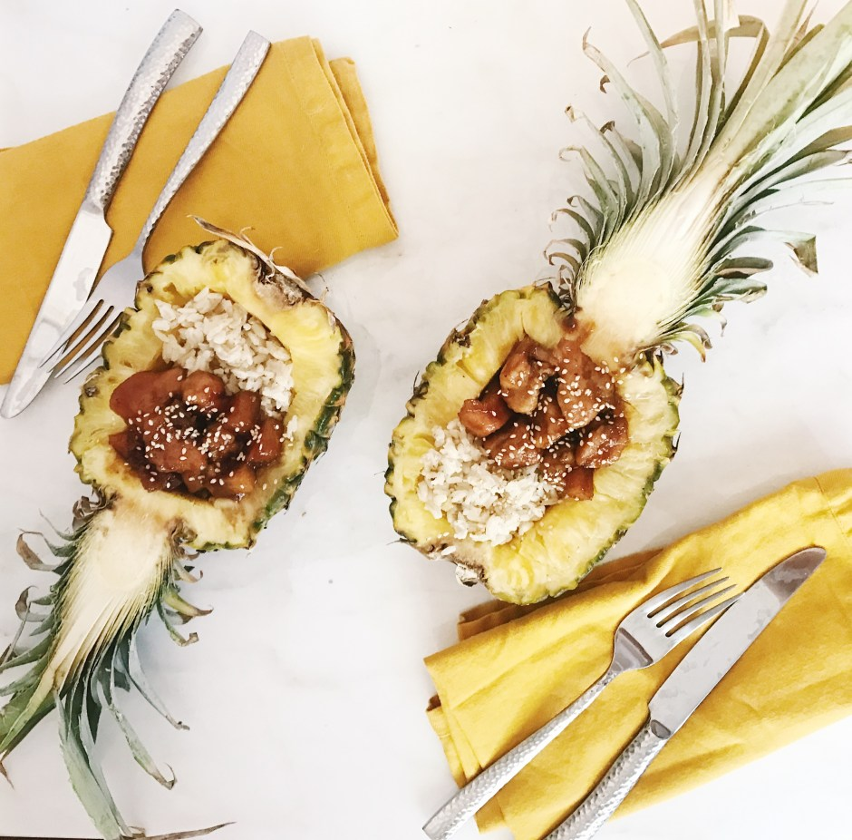 Pineapple chicken in soy sauce with coconut rice, tropical dinner served in a pineapple great for dinner party