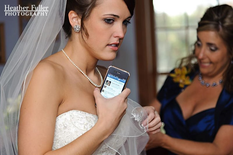 bride-updating-facebook-status-wedding-day