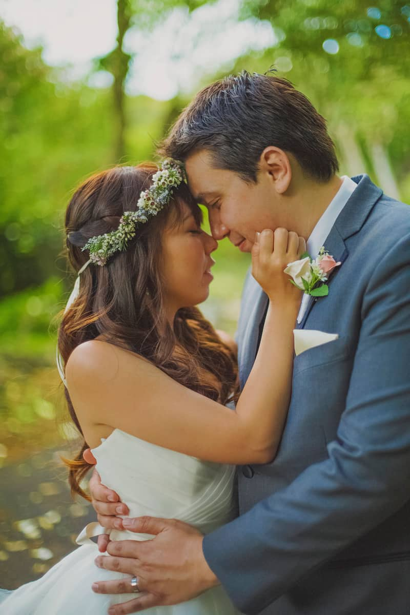Bride and groom destination wedding Hawaii portrait romantic kiss