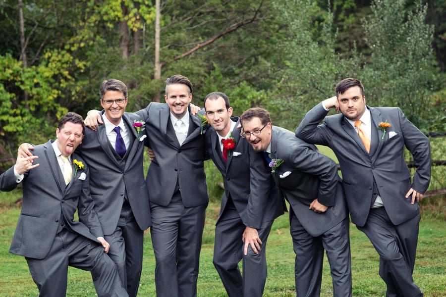 Groomsmen with colourful flowers