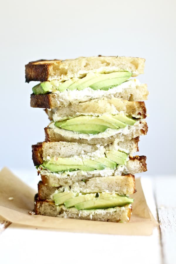 Avocado goat cheese sandwich with herbed butter closeup