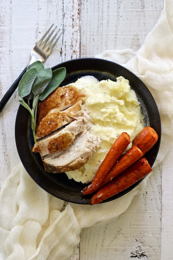 Beautiful mashed potatoes with roasted turkey and carrots