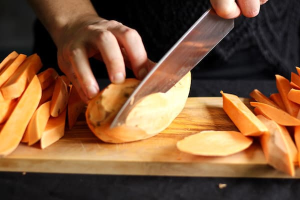 Chop sweet potato fries by slicing a flat surface first so your sweet potato is stable