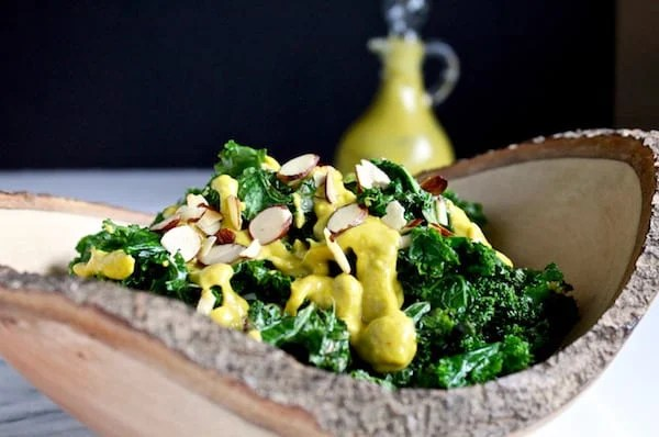 Warm vegan kale salad with roasted red pepper dressing is light, healthy, and delicious!