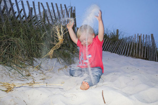 samuel beach playing in sand