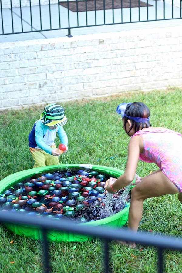 kids playing in water balloon pool