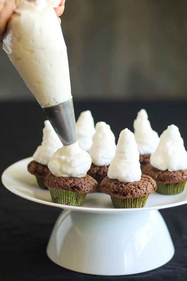 Piping meringue on smores cupcakes