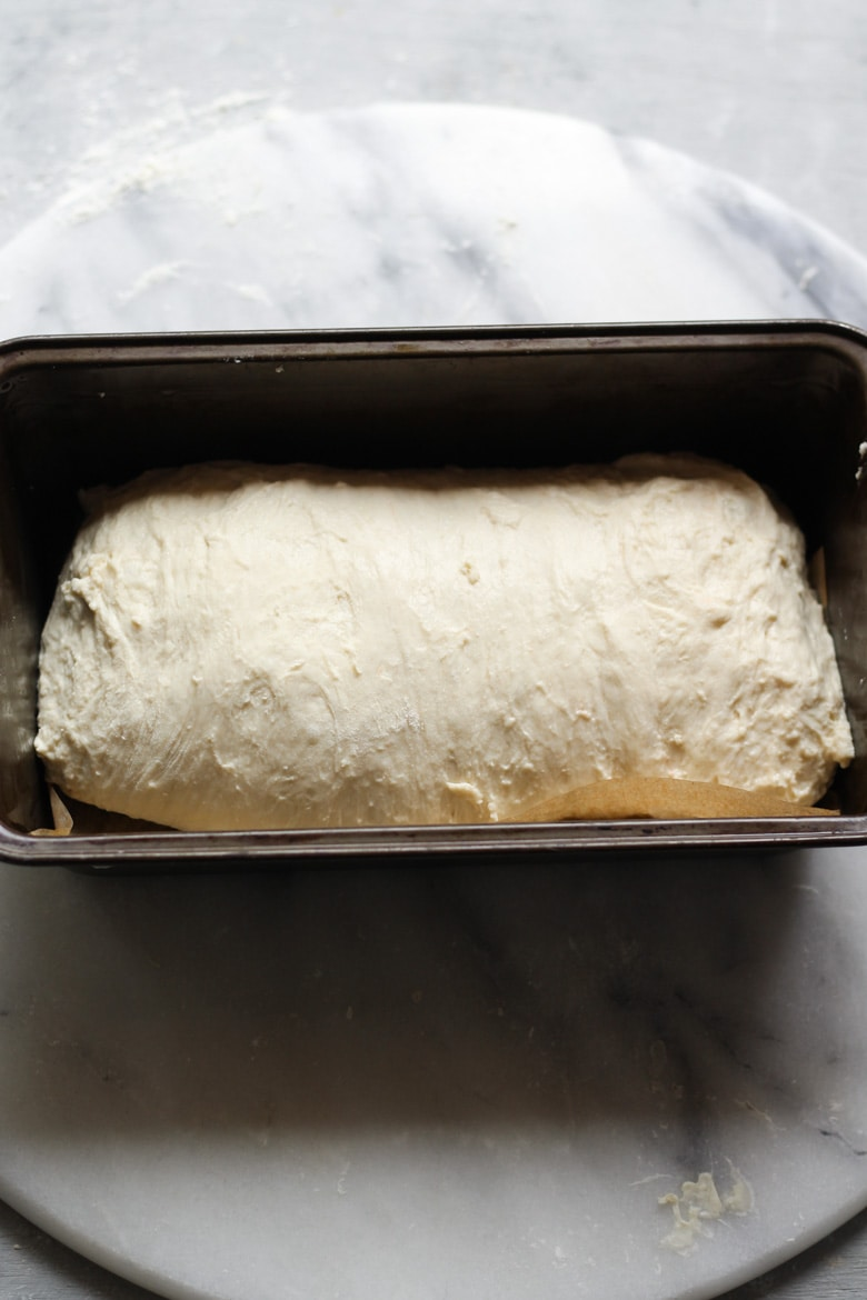 Sourdough bread dough recipe in a loaf tin ready for proofing