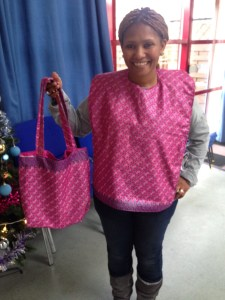 Faith wearing one of our handmade adult bibs and holding matching handmade bag