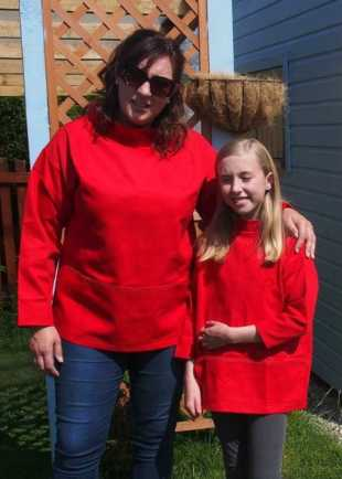Sharon and Jennifer wearing matching red smocks