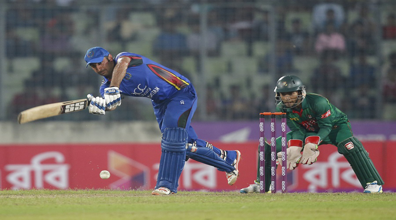 Afghanistan's captain Asghar Stanikzai, left, plays a shot, as Bangladesh's wicketkeeper Mushfiqur Rahim watches during the second one-day international cricket match in Dhaka, Bangladesh, Wednesday, Sept. 28, 2016. (AP Photo/A.M. Ahad)