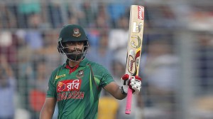 Bangladesh's Tamim Iqbal acknowledges the crowd after scoring fifty runs during the third one-day international cricket match against Afghanistan in Dhaka, Bangladesh, Saturday, Oct. 1, 2016. (AP Photo/A.M. Ahad)