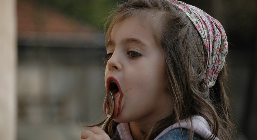 Girl eating Nutella
