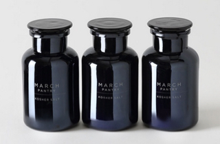 A row of 3 March Pantry Black Kosher Salt containers