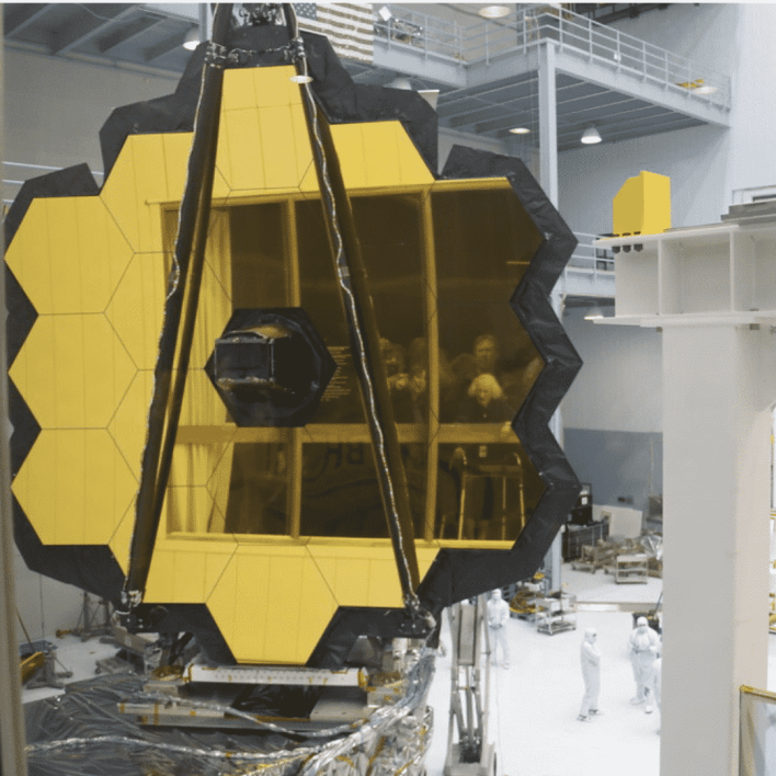 The JWST mirror, 18 segments covered in gold. NASA/GSFC/Jim Jeletic