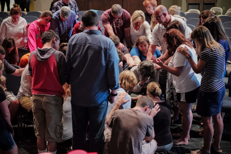Community members surround Shirley Andrews-Sharer during a prayer vigil for her three daughters, Megan, Erin and Kelsi, on Wednesday, July 8, 2015 at Grace Point Community Church in Powell, Ohio. The sisters were reported missing in Teton County, Wyoming while backpacking. As of July 8, the sisters' car had been found at a trailhead and nine search teams were looking for the girls. They had about five days worth of food. The next day, the sisters were found after a local guide tipped search and rescue officials to a location with no trails where he had seen someone walking.
