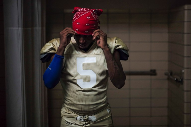 "Team captain Jay Davis, of Reynoldsburg, adjusts his bandana before leaving the locker room for the Thunder's game. ""I like the family part of the team,"" said Davis, who tried to be a part of his high school's team. ""I don't know where I'd be without this team."""