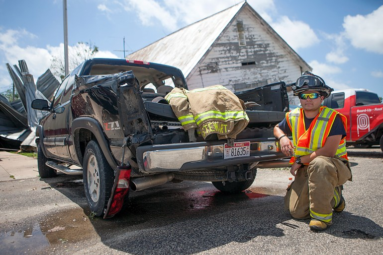 Central Warren firefighter Matt Stewart's truck was heavily damaged as he was storm spotting during Thursday night's tornado that struck Cameron. Despite heavy damage to truck, including a broken rear window, Stewart drove to town to assist in cleanup efforts. STEVE DAVIS/The Register-Mail