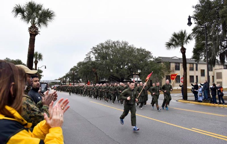 "Teachers from around New England watch the ""Motivational Run"" a day before the recruit graduation on Wednesday, Feb. 25, 2015 at the Marine Corps Educator Workshop at Parris Island in South Carolina. Teachers got a chance to see what life would be like for Marine recruits during the Marine Corps Educator Workshop at Parris Island in South Carolina."
