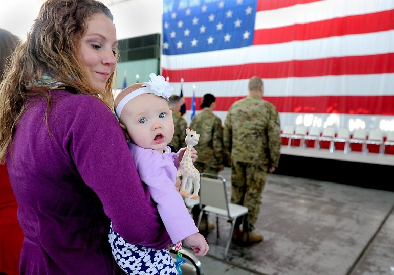 Heather Egert and her daughter Cora at the Call to Duty Ceremony for Company B 3-238th AViation Regiment (GSAB) at the MAPS Air Muesum. Husband and father Sgt. Stephen Egert is a member of the regiment.