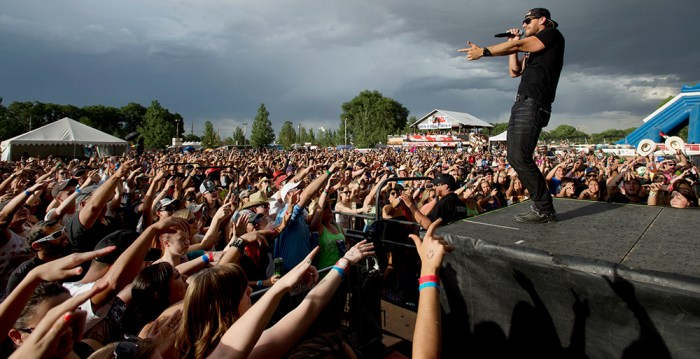 Country recording artist Chase Rice gestures to the crowd as he performs with his band as part of Bands In The Backyard Saturday evening, June 21, 2014, in Pueblo (Bryan Kelsen, The Pueblo Chieftain)