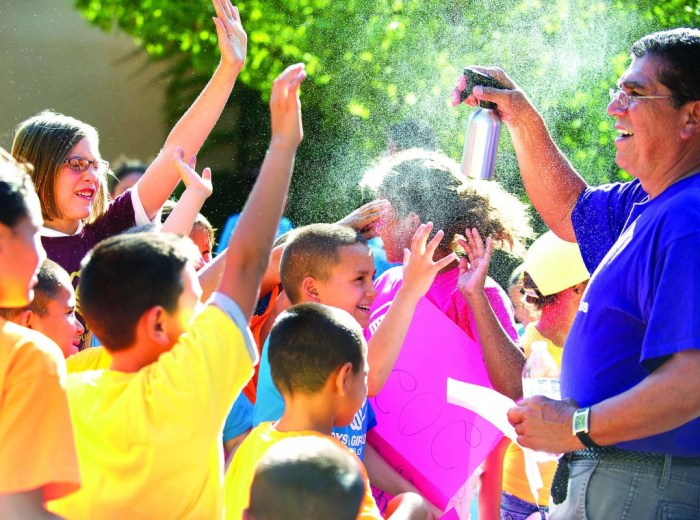 Leader Randy Vialpando sprays water on members of Boys & Girls Clubs of Pueblo County to cool them off during a recent club event. The late summer heat wave of the past two weeks continued Friday. Sept. 6, 2013 in Pueblo, Colo. as temperatures rose into the high 90's. Very hot weather is expected to last into next week. Chris McLean, The Pueblo Chieftain)