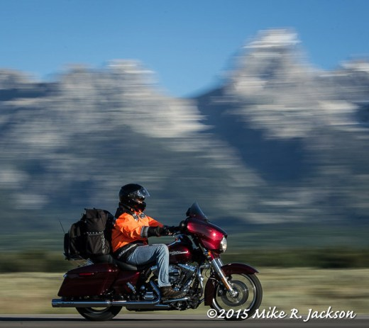 Biker and Blurred Tetons