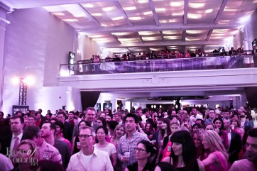 The audience listening to Elisha Cuthbert and Paul Etherington speak about breast cancer