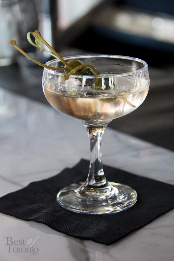 Gin Martini. Gin, Dry French vermouth, drowned caper berries each with blue cheese