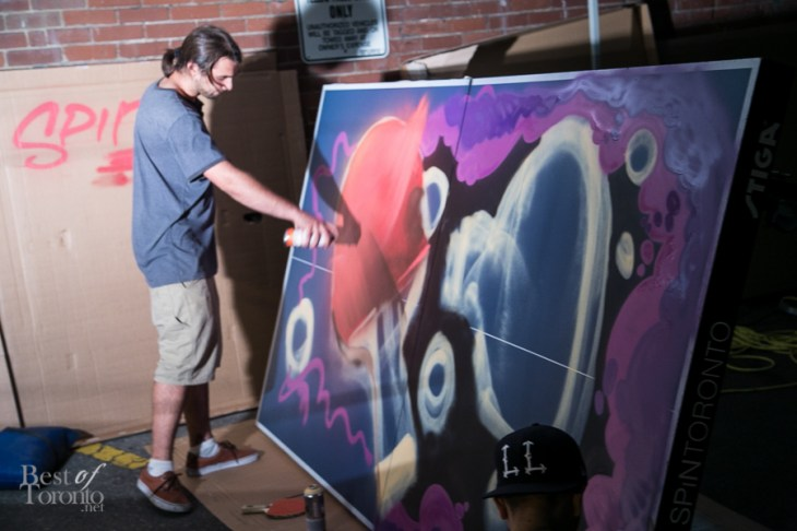 Painting one of the 11 ping pong tables up for auction in support of the Remix project