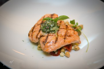 Grilled Atlantic salmon with warm chickpea and cauliflower salad, bariole olives, tomato and cucumber salad